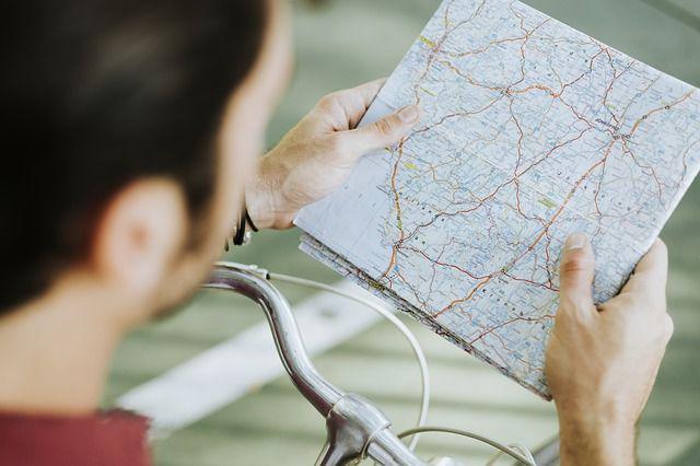 A cyclist checking a map