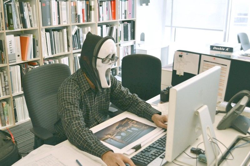 Guy at computer wearing spooky mask from the movie Scream