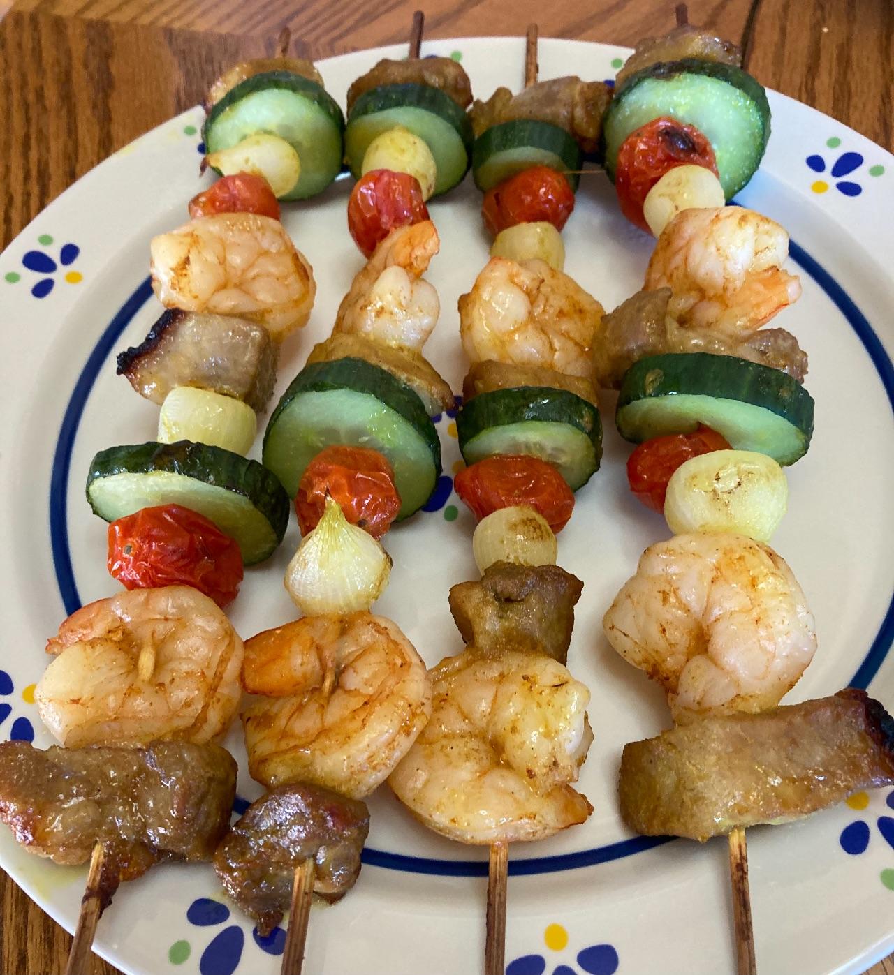 Pork and shrimp kebabs, on a plate