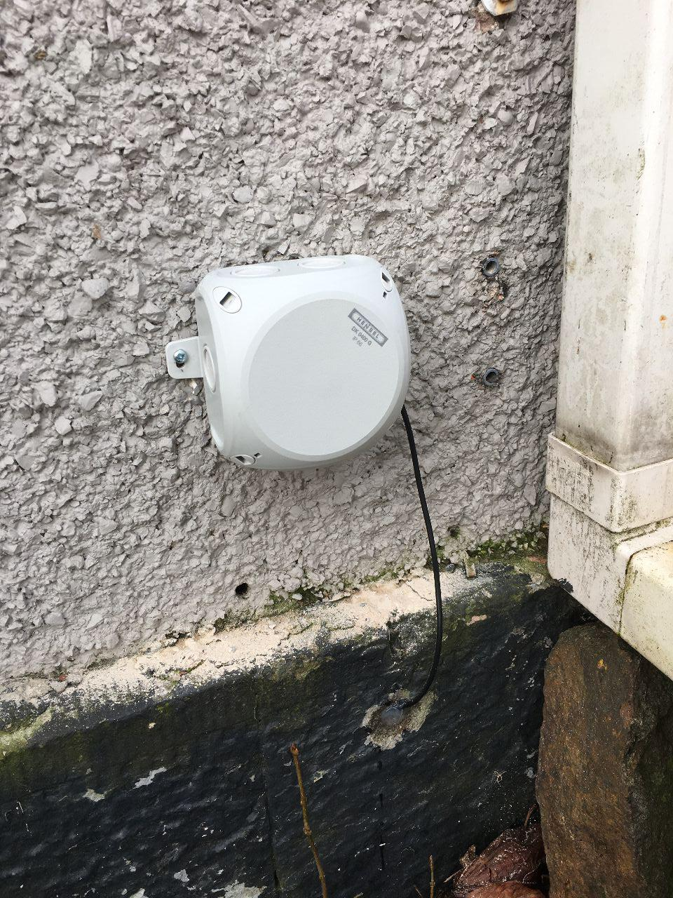 Air quality monitor mounted on wall