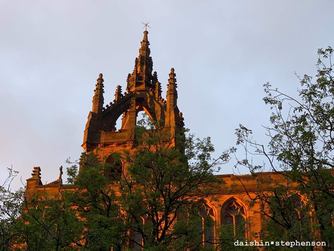 church tower illuminated by light at sunset