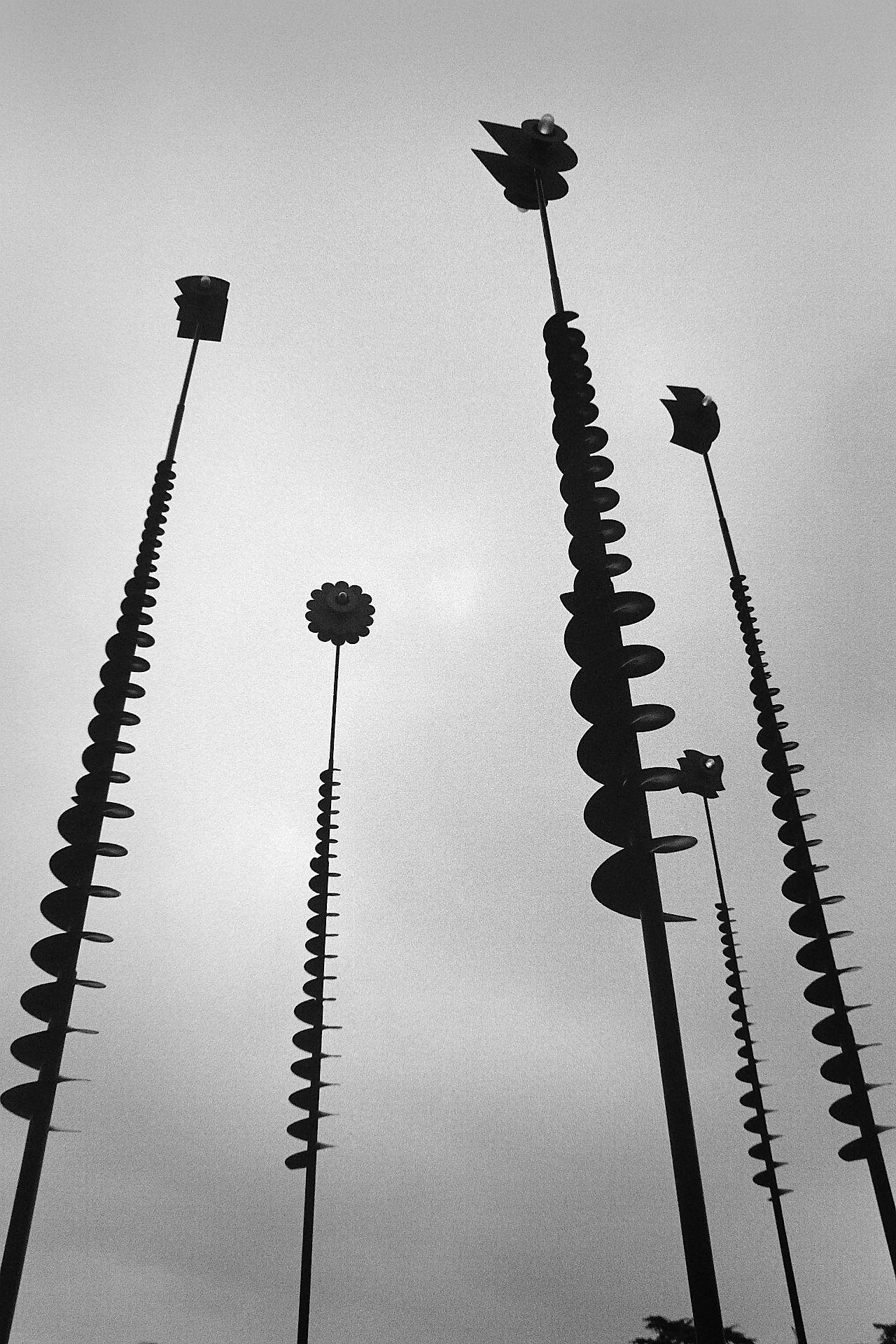 Lamps on top of tall poles with threaded screw spiral attachments