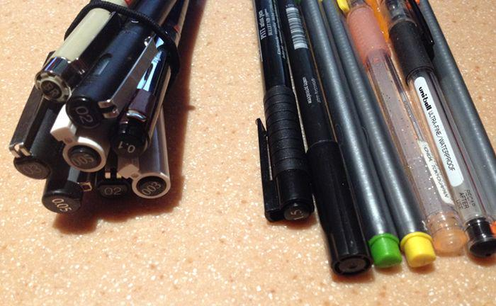 two stacks of pens