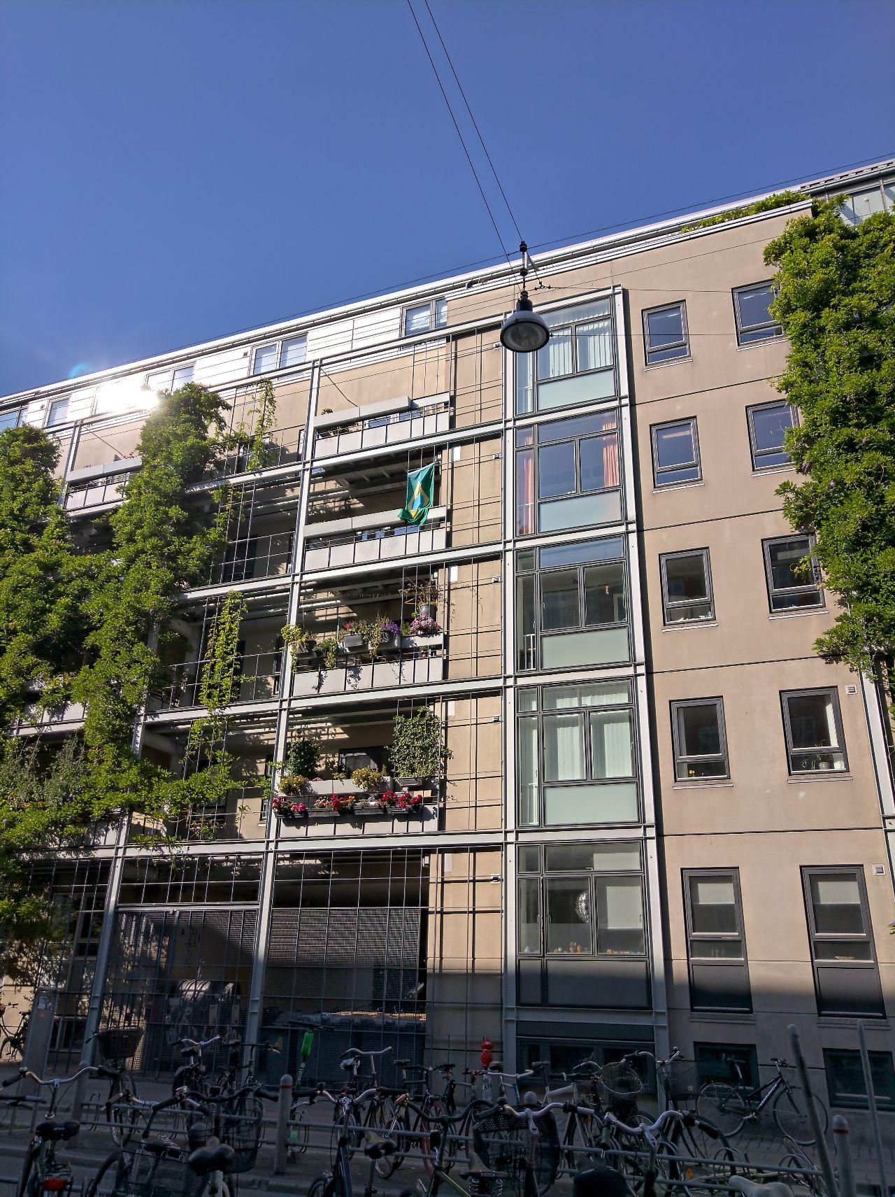 Brazilian flag waving from an apartment in Copenhagen