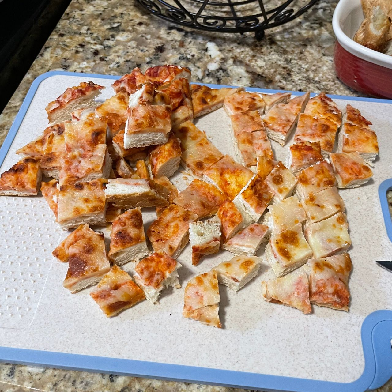 Diced pizza with crust removed for breadsticks.