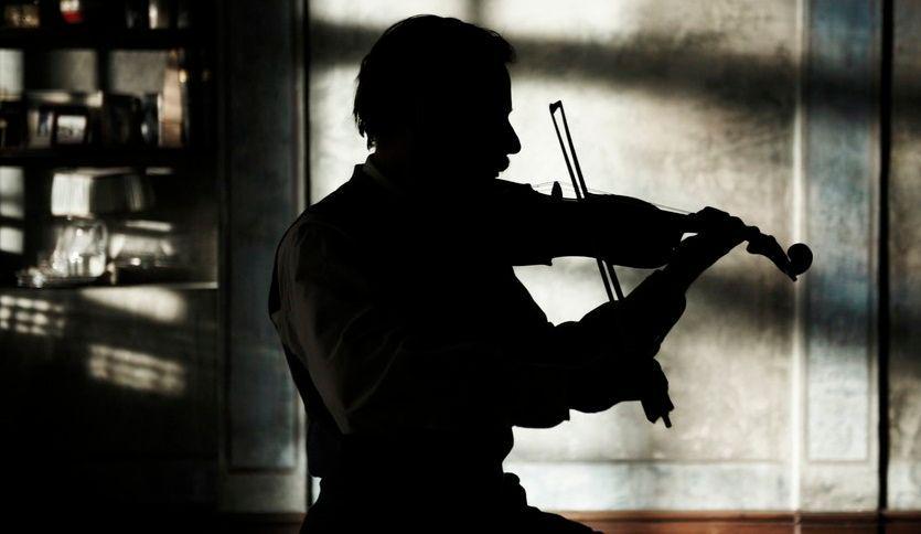 Nasser-Ali playing his violin.