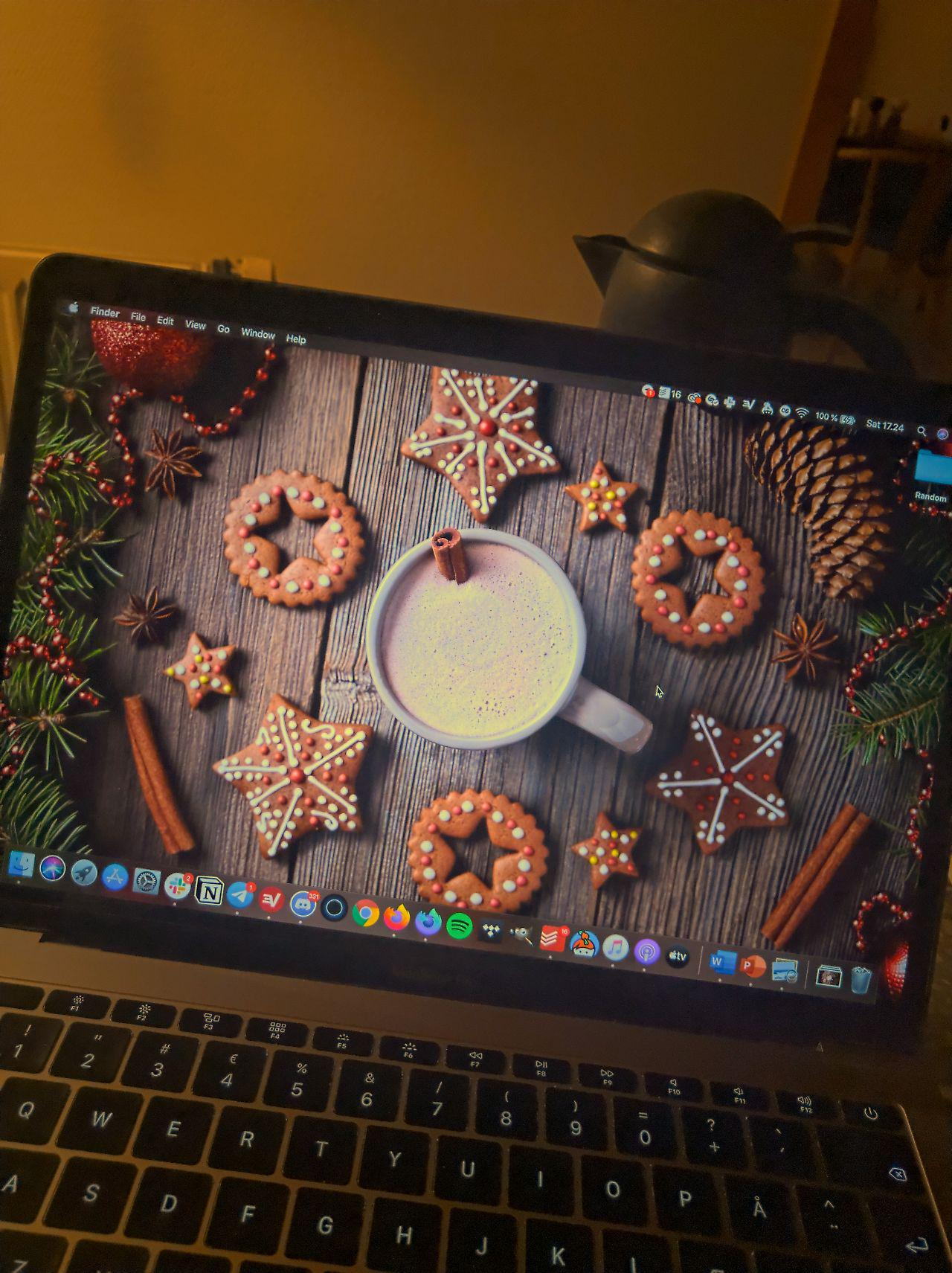 Christmas cookies and hot chocolate as wallpaper on laptop