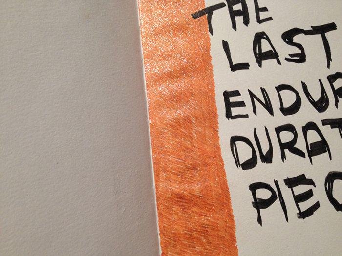 drawing with a glittery orange thick line and black text