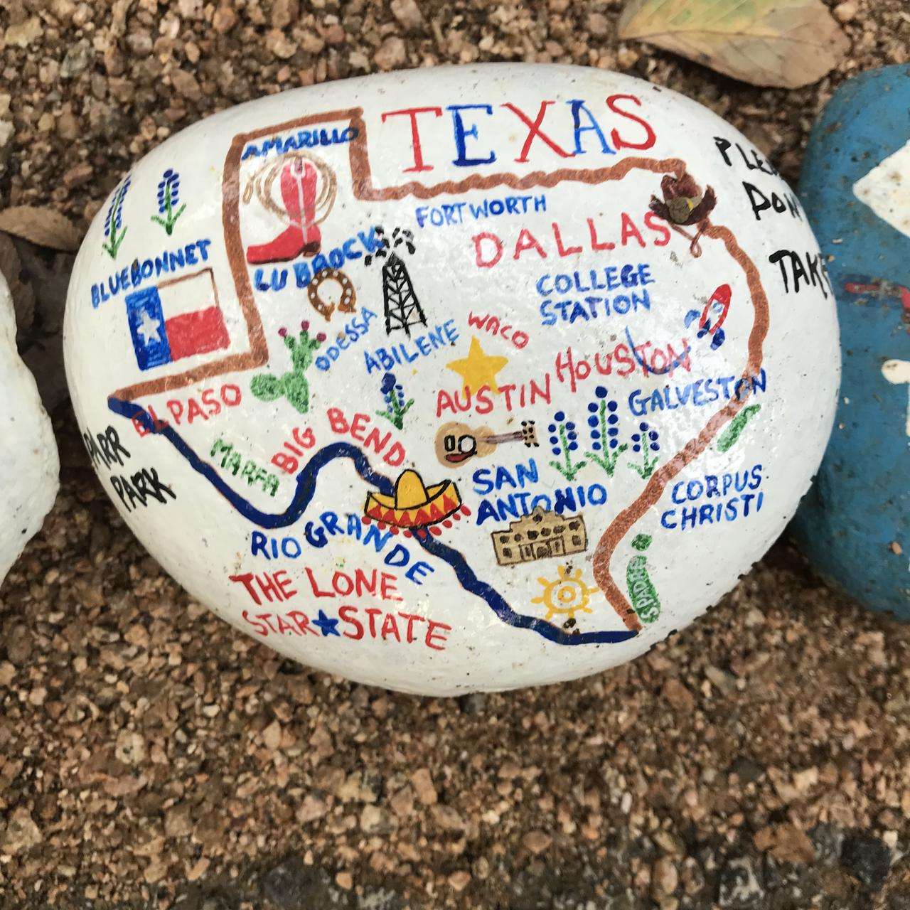 A rock with major Texas cities and regions