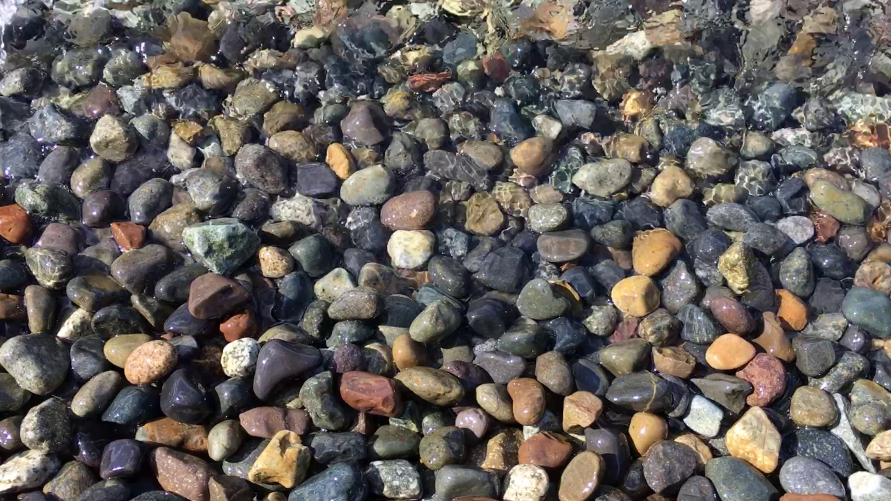 rocky beach pebbles scrubbed in surf