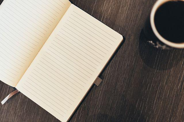 A notebook and a cup of coffee