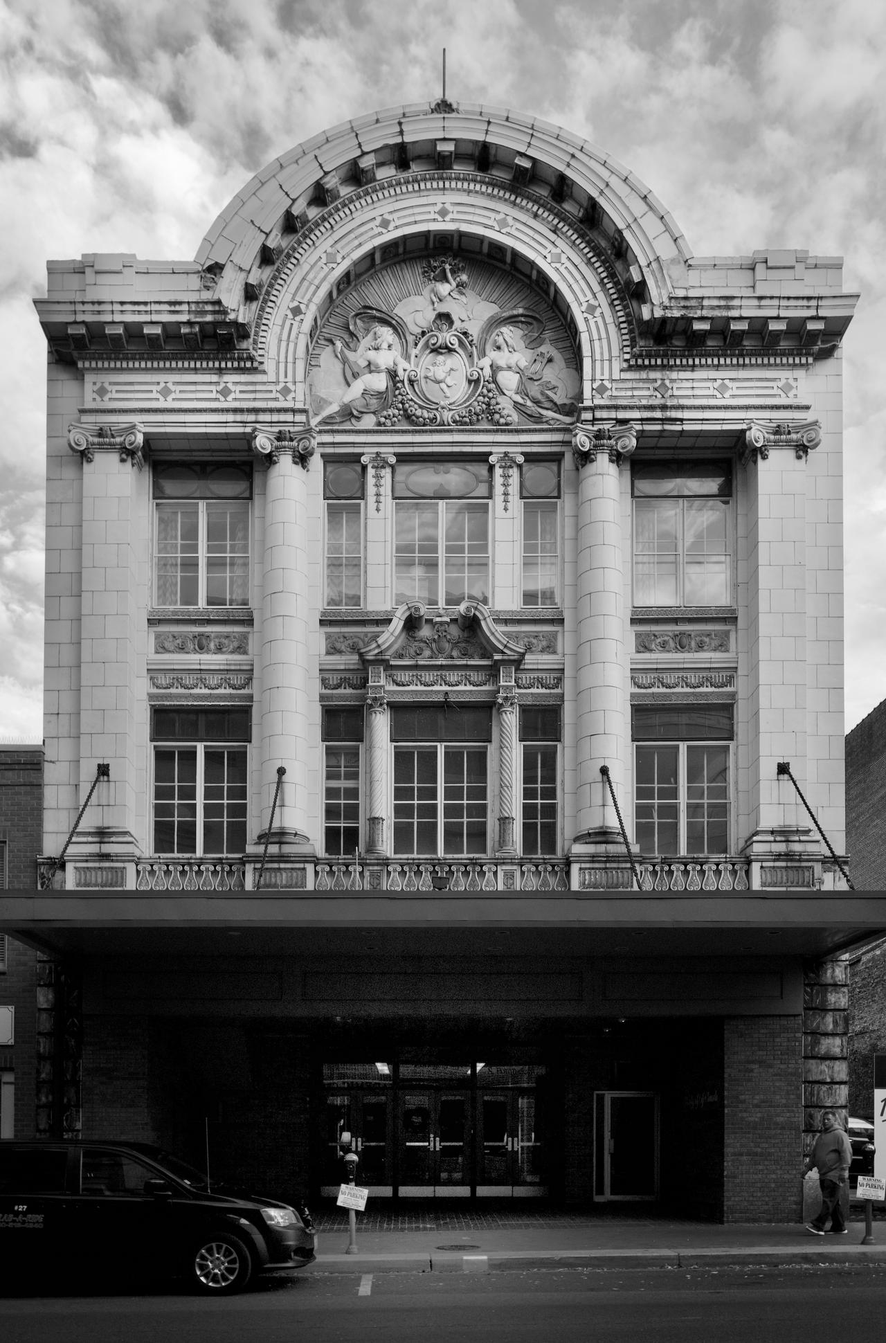 Black and white photo of front of a large theater