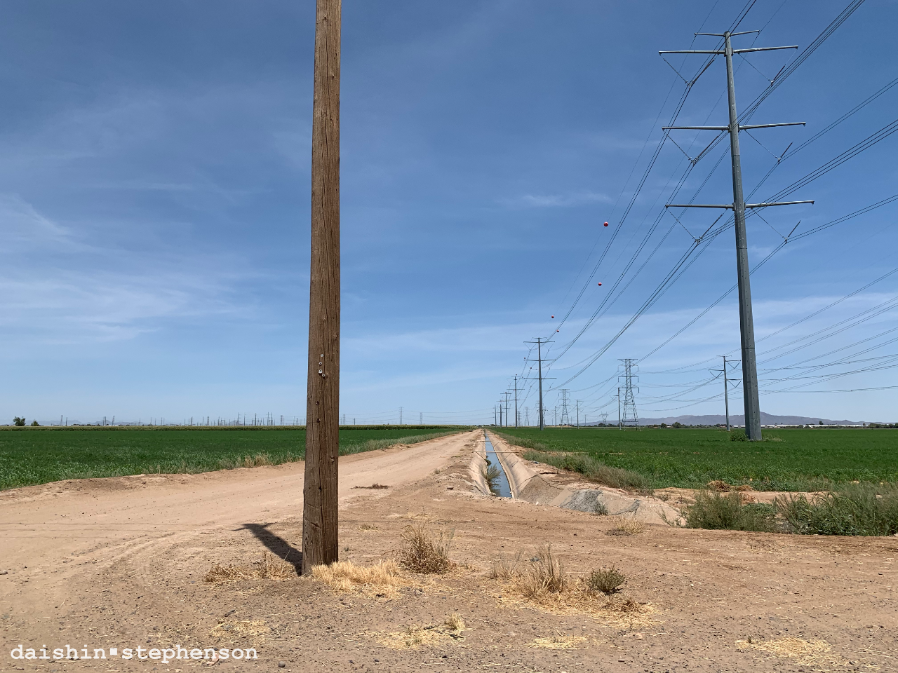 powerlines, alfalfa field, irrigation canal, farm access road