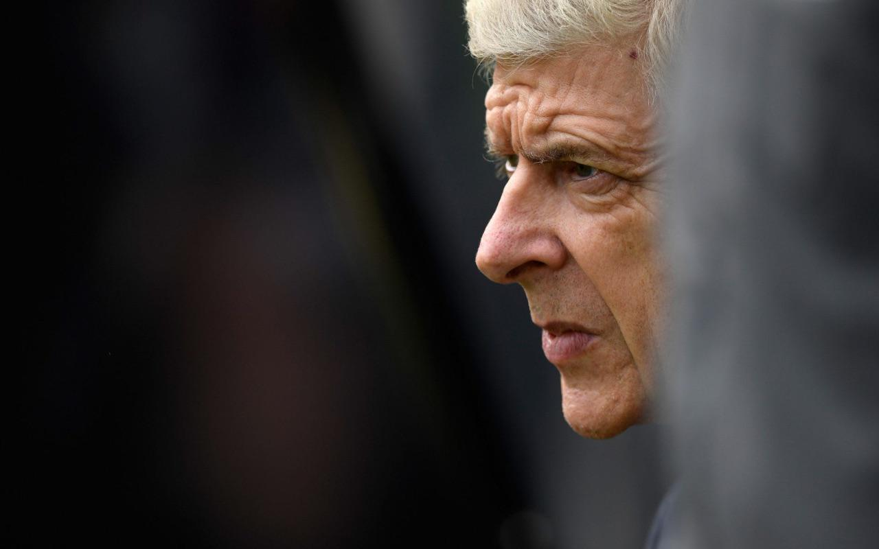 Arsene Wenger deep in thought