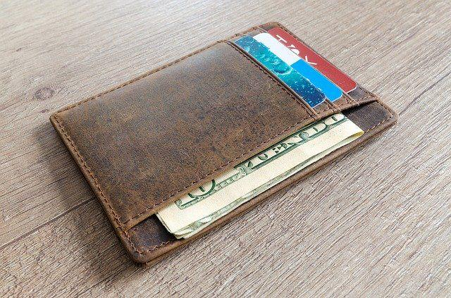 A wallet with cards and cash
