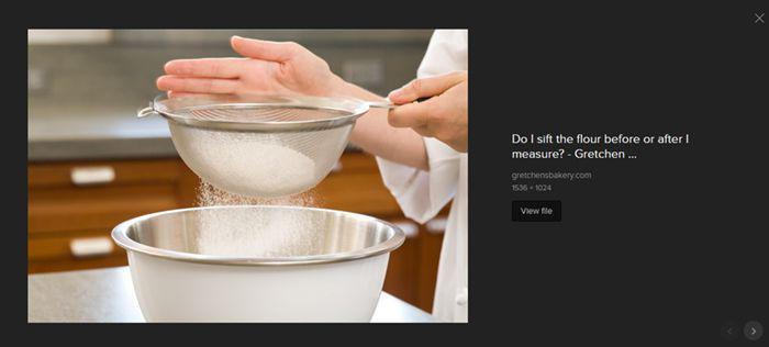 stock photo of flour being sifted