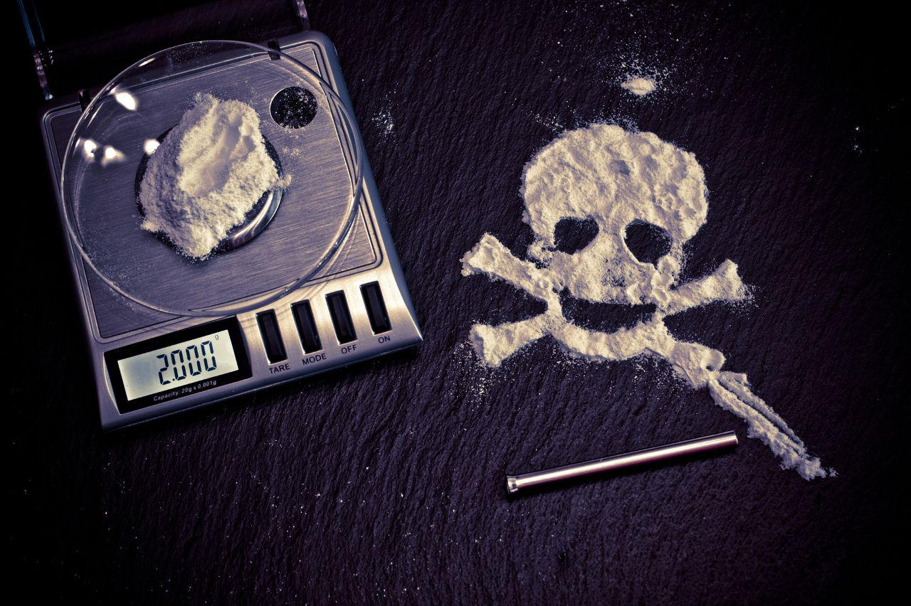 an image of flour on a scale and a skull shape next to it