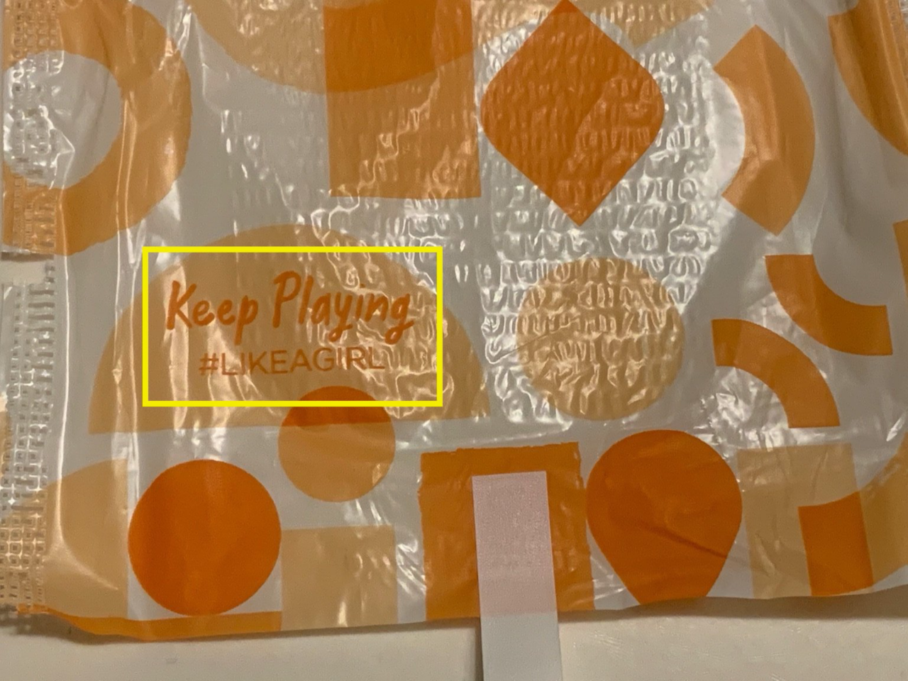 sanitary napkin wrapper with hashtag keep playing like a girl