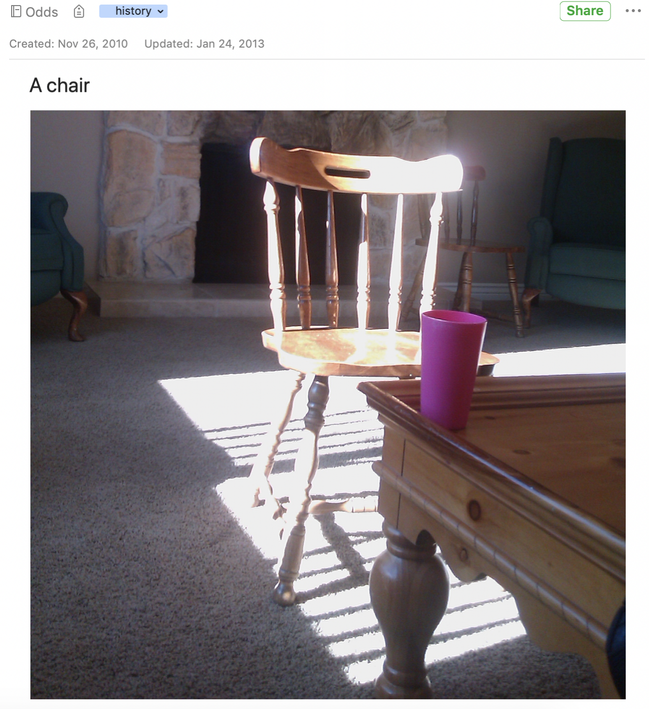 A very plain photo of a chair in some sunlight.