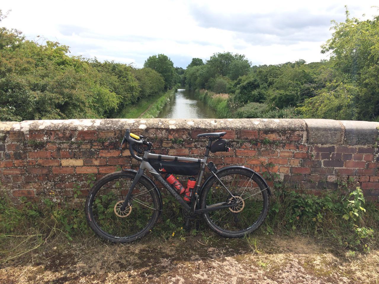 A gravel bike on a canal bridge
