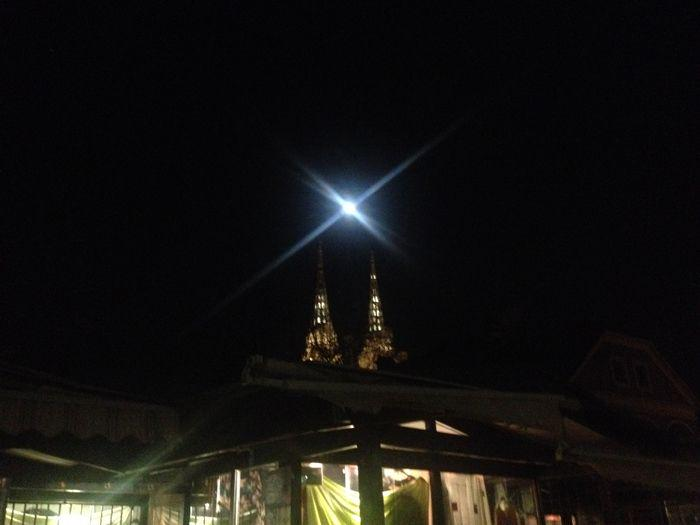 the full moon above a cathedral